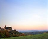 AUSTRIA, Bernstein, Burg Bernstein Castle at sunrise with the full moon setting, Burgenland