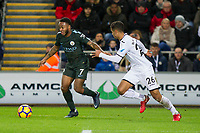 Raheem Sterling of Manchester City and Kyle Naughton of Swansea City during the EPL - Premier League match between Swansea City and Manchester City at the Liberty Stadium, Swansea, Wales on 13 December 2017. Photo by Mark  Hawkins / PRiME Media Images.