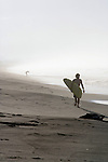 Surfer Walking On Beach