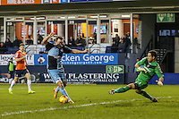 Garry Thompson of Wycombe Wanderers rounds Mark Tyler of Luton Town to open the scoring against Luton Town during the Sky Bet League 2 match between Luton Town and Wycombe Wanderers at Kenilworth Road, Luton, England on 26 December 2015. Photo by David Horn.