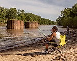 May 4, 2018. Fayetteville, North Carolina.<br /> <br /> Orrion Hill fishes at the William O Huske Dam. This is the dam closest to the Chemours plant.<br /> <br /> The Chemours Company, a spin off from DuPont, manufactures many chemicals at its plant in Fayetteville, NC. One of these, commonly referred to as GenX, is part of the process of teflon manufacturing. Chemours has been accused of dumping large quantities of GenX into the Cape Fear River and polluting the water supply of city's down river and allowing GenX to leak into local aquifers.