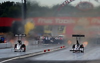 Sept. 6, 2010; Clermont, IN, USA; NHRA top fuel dragster driver Rod Fuller (left) races Steve Torrence during the U.S. Nationals at O'Reilly Raceway Park at Indianapolis. Mandatory Credit: Mark J. Rebilas-