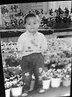 "Picture of a little boy, Chen Shuai, born on 1 Mach 1996, lost in GuanDu district in Kumming city on 26 March 2001. Message reads ""Son, it's been 11 years. We miss you every single day until you return.""..PHOTO BY SINOPIX"