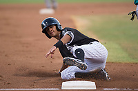 AZL White Sox second baseman Kevin Maldonado (5) slides into third base during an Arizona League game against the AZL Mariners at Camelback Ranch on July 8, 2018 in Glendale, Arizona. The AZL White Sox defeated the AZL Mariners 8-5. (Zachary Lucy/Four Seam Images)