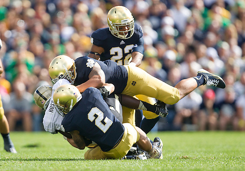 September 08, 2012:  Notre Dame cornerback Bennett Jackson (2) and inside linebacker Manti Te'o (5) team up to tackle Purdue wide receiver O.J. Ross (4) during NCAA Football game action between the Notre Dame Fighting Irish and the Purdue Boilermakers at Notre Dame Stadium in South Bend, Indiana.  Notre Dame defeated Purdue 20-17.