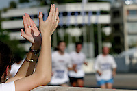 02 NOV 2003 -  ATHENS, GREECE -  A spectator applauds finishers as they arrive at the Kallimarmaro Stadium at the end of the 21st Athens Classic Marathon. (PHOTO (C) NIGEL FARROW)