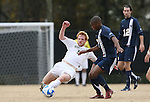 02 December 2007: Wake Forest's Patrick Phelan (5) challenges West Virginia's Gift Maworere (ZIM) (7) for the ball. The Wake Forest University Demon Deacons defeated the West Virginia University Mountaineers 3-1 at W. Dennie Spry Soccer Stadium in Winston-Salem, North Carolina in a Third Round NCAA Division I Mens Soccer Tournament game.