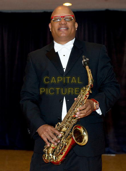Ski Johnson.2012 White House Correspondents Association (WHCA) Annual Dinner held at the Washington Hilton Hotel, Washington, D.C., USA..April 28th, 2012.half length black white tuxedo glasses saxophone .CAP/ADM/RS.©Ron Sachs/CNP/AdMedia/Capital Pictures.