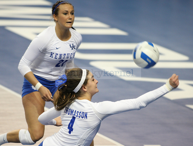 Freshman Anni Thomasson dives to hit the ball during the UK vs. LSU women's volleyball game at Memorial Coliseum in Lexington, Ky., on Sunday, November 10, 2013. UK won the set 3-2. Photo by Tessa Lighty | Staff