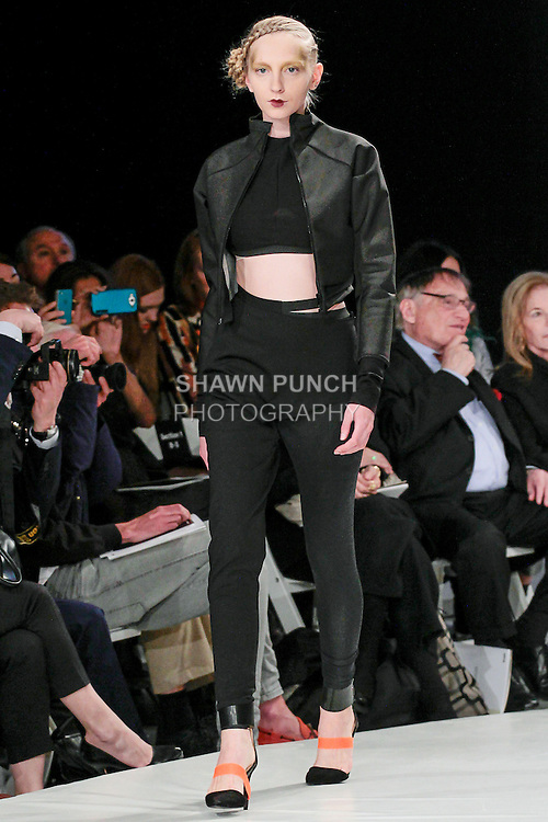 Model walks runway in an outfit by Jefferson Musanda, during the 2013 Pratt Institute Fashion Show, on April 25, 2013.