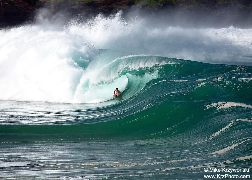 Body boarder getting barreled on a large wave at Waimea Bay Shorbreak, North Shore, Oahu