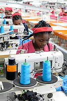 ETHIOPIA , Southern Nations, Hawassa or Awasa, Hawassa Industrial Park, chinese-built for the ethiopian government to attract foreign investors with low rent and tax free to establish a textile industry and create thousands of new jobs, taiwanese company Everest Textile Co. Ltd.produces textiles from synthetic fabric for export / AETHIOPIEN, Hawassa, Industriepark, gebaut durch chinesische Firmen fuer die ethiopische Regierung um die Hallen fuer Textilbetriebe von Investoren zu vermieten, taiwanesische Firma Everest Textile Co. Ltd. produziert Textilien aus synthetischen Stoffen fuer den Export, Textilarbeiterin Martha (20)