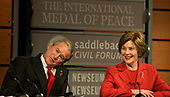 United States President George W. Bush and first lady Laura Bush participate in the Saddleback Civil Forum on Global Health at the Newseum in Washington, D.C., Monday, December 1, 2008.<br /> Credit: Mannie Garcia / Pool via CNP