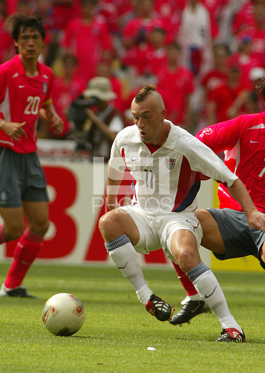 Clint Mathis tries to control the ball. The USA tied South Korea, 1-1, during the FIFA World Cup 2002 in Daegu, Korea.