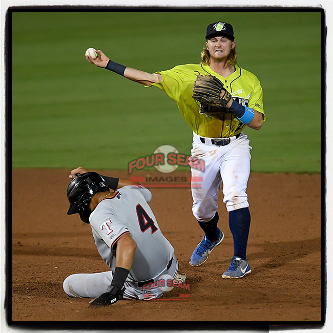 Second baseman Nick Conti (21) of the Columbia Fireflies makes the putout on Pedro Gonzalez (4) of the Hickory Crawdads and throws to first in a game on Wednesday, August 28, 2019, at Segra Park in Columbia, South Carolina. Hickory won, 7-0. (Tom Priddy/Four Seam Images) #MiLB