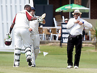 Maxwell Creese (L) of North Middx is restrained by Alex Hill after disputing being given out LBW with the umpire during the Middlesex County Cricket League Division Two game between North Middlesex and Winchmore Hill at Park Road, Crouch End on Saturday June 12, 2010
