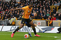 Willy Boly of Wolverhampton Wanderers and Leandro Trossard of Brighton & Hove Albion during Wolverhampton Wanderers vs Brighton & Hove Albion, Premier League Football at Molineux on 7th March 2020