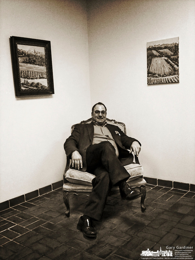 Artist Dennis Rano sits in one of the room of the exhibition space at his gallery and studio in Westerville, Ohio.