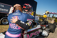 Oct 16, 2016; Ennis, TX, USA; NHRA top fuel driver Steve Torrence (right) hugs race winner Antron Brown during the Fall Nationals at Texas Motorplex. Mandatory Credit: Mark J. Rebilas-USA TODAY Sports