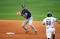 San Antonio Missions shortstop Trea Turner (4) turns a double play as Mike Bianucci (33) heads towards second during a game against the NW Arkansas Naturals on May 31, 2015 at Arvest Ballpark in Springdale, Arkansas.  NW Arkansas defeated San Antonio 3-1.  (Mike Janes/Four Seam Images)