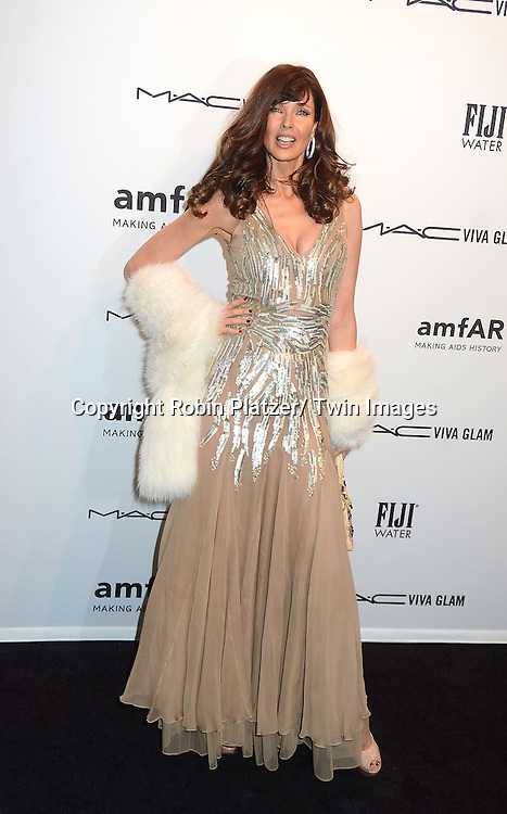 Carol Alt in Blumarine dress attends the amfAR New York Gala to kick off Fashion Week on February 6, 2013 at Cipriani Wall Streetin New York City. The honorees were Heidi Klum, Janet Jackson  and Kenneth Cole.