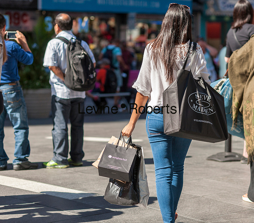 Visitor to Times Square in New York with her purchases on Thursday, September 15, 2016.  U.S. retail sales for August were below analysts' expectations as automobile and gasoline sales were weak and shoppers abandoned their spending spree from the spring.  (© Richard B. Levine)