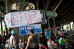 At the Khlong Toey protest camp, this sign reads, &quot;Where are you, father&quot;, a common way to refer to Thailand's king.<br /> <br /> From March to May 2010, Red Shirt protestors occupied several sites in Bangkok in an attempt to oust the government, who they believed had come to power illegitimately. <br /> <br /> When the tanks finally rolled in, clearing away the last of the Red Shirts, more than 80 people had been killed and more than 2,000 injured.