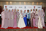 Mayalsian fashion designer Eja Shahril poses with models and guest after her Eja Shahril collection fashion show for Couture Fashion Week Spring 2018 at the Crowne Plaza Times Square in Manhattan, on September 8, 2017; during New York Fashion Week.