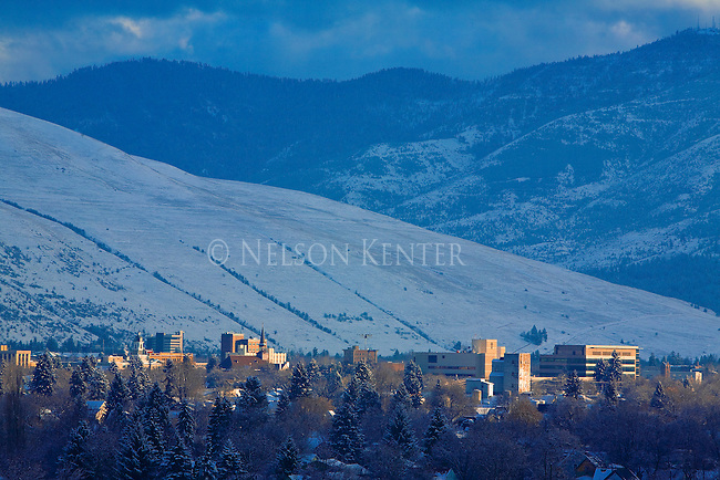 The Missoula, Montana valley as the setting sun hits the building of downtown