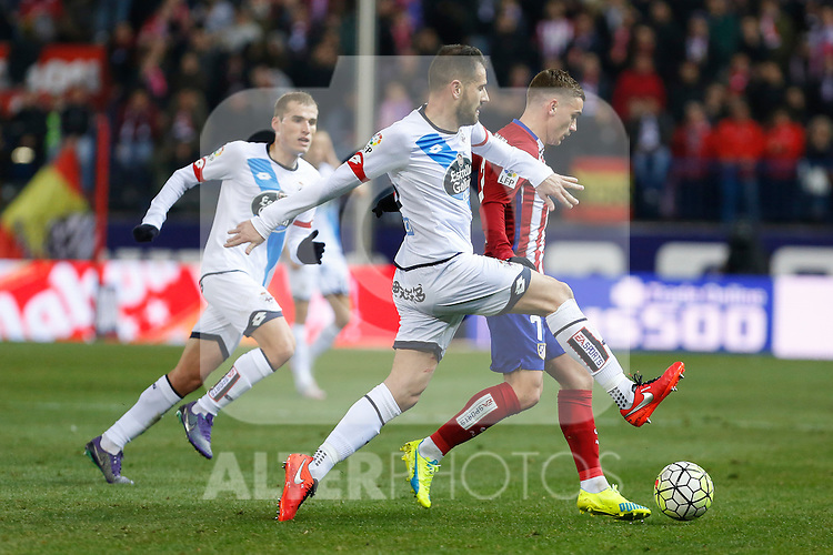 Atletico de Madrid´s Antoine Griezmann and Deportivo de la Coruna´s Lopo during 2015-16 La Liga match between Atletico de Madrid and Deportivo de la Coruna at Vicente Calderon stadium in Madrid, Spain. March 12, 2016. (ALTERPHOTOS/Victor Blanco)