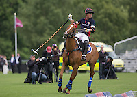 Apichet Srivaddhanaprabha (King Power) celebrates scoring the winner during the Cartier Trophy Final match between King Power and Salkeld at the Guards Polo Club, Windsor, Smith's Lawn, England on 14 June 2015. Photo by Andy Rowland.