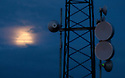 20/06/16 <br /> <br /> Strawberry Moon behind radio masts on Alport Height.<br /> <br /> On the shortest night of the year, photographers take shots of the setting sun behind Alport Stone, while a 'Strawberry Moon' rises behind them above Alport Height near Wirksworth, Derbyshire. The next time this rare summer moon, which some say gets its name as it marks the start of the strawberry picking season,  will be seen on the night of the summer solstice will be in 46 years time.<br /> <br /> All Rights Reserved F Stop Press Ltd +44 (0)1335 418365