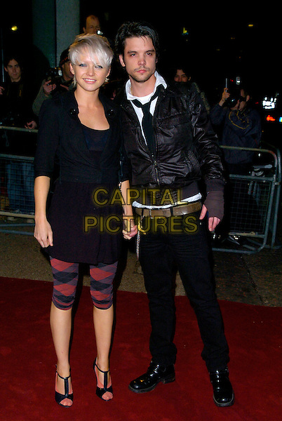 "GUESTS.Arrives at ""An Audience With Take That"".at The London Television Studios,.London, England, December 2nd 2006..Full length red tartan leggings.CAP/CAN.©Can Nguyen/Capital Pictures"