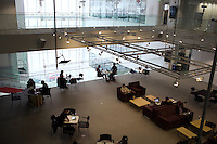 People gather in common areas in MIT's Media Lab (Building E14) at MIT in Cambridge, Massachusetts, USA.
