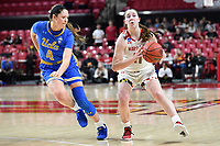 College Park, MD - March 25, 2019: Maryland Terrapins guard Taylor Mikesell (11) dribbles past UCLA Bruins guard Lindsey Corsaro (4) during second round game of NCAAW Tournament between UCLA and Maryland at Xfinity Center in College Park, MD. UCLA advanced to the Sweet 16 defeating Maryland 85-80.(Photo by Phil Peters/Media Images International)
