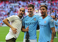 Manager, Pep Guardiola, John Stones and Kyle Walker celebrate Manchester City winning the FA Community Shield during Chelsea vs Manchester City, FA Community Shield Football at Wembley Stadium on 5th August 2018