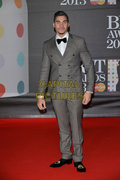 Louis Smith.The Brit Awards 2013 arrivals at the O2, Greenwich, London, England 20th February 2013.The Brits full length bow tie tuxedo double breasted grey gray tweed suit gold black loafers .CAP/PL.©Phil Loftus/Capital Pictures.