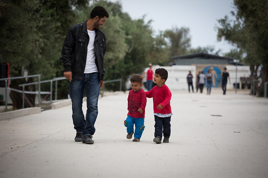 Logman, Turkish-Kurdish refugee from Iraq with sons Judi and Bilal at Kara Tepe site on the island of Lesvos, Greece.