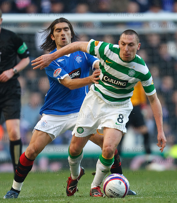 Pedro Mendes and Scott Brown battle in midfield