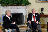 Washington, D.C. - September 27, 2007 -- United States President George W. Bush meets with the Secretary of Transportation Mary E. Peters and the Acting Administrator of the Federal Aviation Administration Robert A. Sturgell in the Oval Office of the White House in Washington, D.C. on Thursday, September 27, 2007.  .Credit: Ron Sachs - Pool via CNP