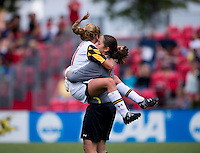 Lauren Berman (11) of Maryland jumps into the arms of teammate Rachelle Beanlands (33) after the game at Ludwig Field in College Park, MD.  Maryland defeated Wake Forest, 1-0.