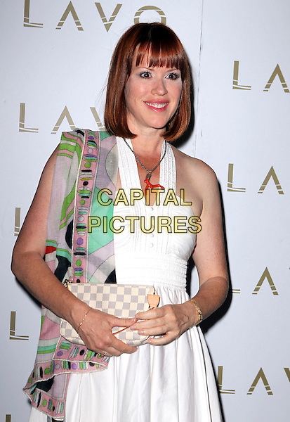 "MOLLY RINGWALD .Pretty In Pink hosted by Molly Ringwald celebrating the release of her book ""Getting the Pretty Back"" at LAVO Nightclub at The Palazzo Resort Casino, Las Vegas, Nevada, USA, .29th June 2009..half length white sun dress pucci print scarf green clutch bag .CAP/ADM/MJT.© MJT/AdMedia/Capital Pictures."