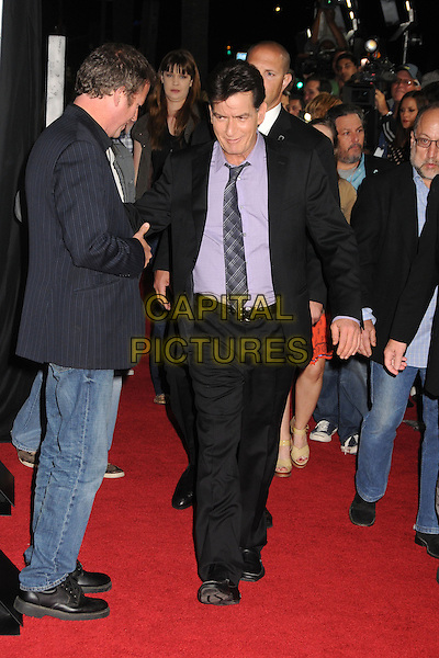"Charlie Sheen.Attending the ""Scary Movie 5"" Los Angeles film premiere held at the Cinerama Dome,  Hollywood, California, USA, .11th April 2013..full length black suit purple shirt tie belt shoes waling .CAP/ADM/BP.©Byron Purvis/AdMedia/Capital Pictures"