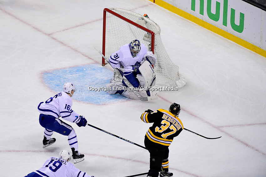 April 21, 2018: Boston Bruins center Patrice Bergeron (37) shoots at Toronto Maple Leafs goaltender Frederik Andersen (31) during game five of the first round of the National Hockey League's Eastern Conference Stanley Cup playoffs between the Toronto Maple Leafs and the Boston Bruins held at TD Garden, in Boston, Mass. Toronto defeats Boston 4-3, Boston leads Toronto 3 games to 2 in the best of 7 series.