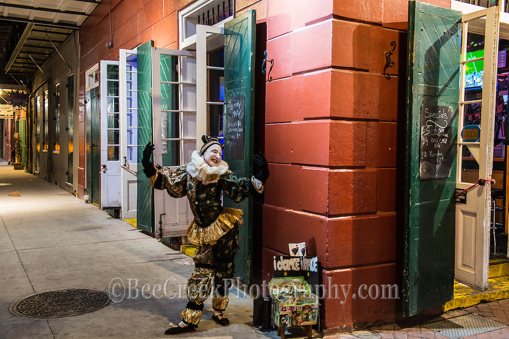 A bourbon street mime performs her dance for the crowds in the French quarter.