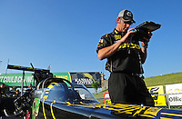 May 18, 2012; Topeka, KS, USA: NHRA top fuel dragster driver Morgan Lucas sits in his car as crew chief Aaron Brooks makes a computer adjustment during qualifying for the Summer Nationals at Heartland Park Topeka. Mandatory Credit: Mark J. Rebilas-