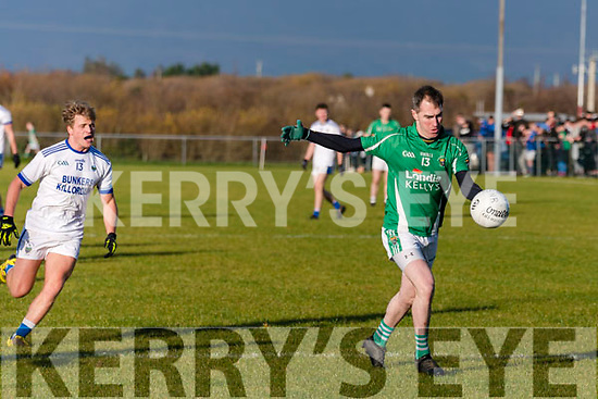 In the Mid Kerry Senior Championship Final 2019 at Glenbeigh/Glencar's pitch on Sunday, Milltown/Castlemaine's Cathal Moriarty lines up a point under pressure from Fiacra Clifford of Laune Rangers