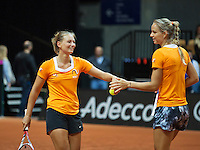 13 April, 2016, France, Trélazé, Arena Loire,   Semifinal FedCup, France-Netherlands, Dutch team practise, doubles,  Arantxa Rus (R) and Cindy Burger<br /> Photo: Henk Koster/tennisimages