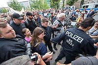 """Schuelerstreik und Demonstration """"Fridays4Future"""" (#f4f) in Berlin.<br /> Ca. 2.000 Menschen, hauptsaechlich Schuelerinnen und Schueler versammelten sich am Freitag den 19. Juli 2019 in Berlin mit ihrer woechentlichen Klimademonstration vor dem Wirtschaftsministerium in Berlin. Sie protestieren gegen die Klimapolitik der Wirtschaft und der Bundesregierung und fordern die Einhaltung der """"Pariser Klimaziele"""", die eine Begrenzung der Erderwaermung auf 1,5°C vorsieht.<br /> Als Gast sprach die schwedische Klimaschutzaktivistin Greta Thunberg, die mit ihrem individuellen Schulstreik die """"Fridays for Future"""" ausgeloest hat.<br /> Im Bild: Polizei und Security muessen Greta Thunberg (links mit rosa T-Shirt) nach ihrer Rede schuetzen, da sie von Unmengen von Journalisten verfolgt und bedraengt wurde. Vor ihr, Luisa-Marie Neubauer von Fridays 4 Future.<br /> 19.7.2019, Berlin<br /> Copyright: Christian-Ditsch.de<br /> [Inhaltsveraendernde Manipulation des Fotos nur nach ausdruecklicher Genehmigung des Fotografen. Vereinbarungen ueber Abtretung von Persoenlichkeitsrechten/Model Release der abgebildeten Person/Personen liegen nicht vor. NO MODEL RELEASE! Nur fuer Redaktionelle Zwecke. Don't publish without copyright Christian-Ditsch.de, Veroeffentlichung nur mit Fotografennennung, sowie gegen Honorar, MwSt. und Beleg. Konto: I N G - D i B a, IBAN DE58500105175400192269, BIC INGDDEFFXXX, Kontakt: post@christian-ditsch.de<br /> Bei der Bearbeitung der Dateiinformationen darf die Urheberkennzeichnung in den EXIF- und  IPTC-Daten nicht entfernt werden, diese sind in digitalen Medien nach §95c UrhG rechtlich geschuetzt. Der Urhebervermerk wird gemaess §13 UrhG verlangt.]"""