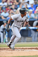 Augusta GreenJackets shortstop Manuel Geraldo (26) swings at a pitch during a game against the Asheville Tourists at McCormick Field on June 15, 2018 in Asheville, North Carolina. The Tourists defeated the GreenJackets 6-5. (Tony Farlow/Four Seam Images)